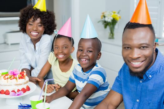 Happy family celebrating birthday party at home