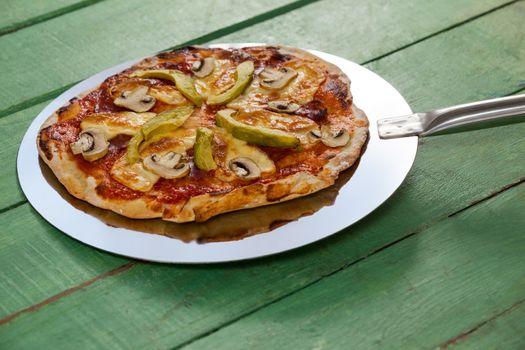 Delicious italian pizza served on pizza peel