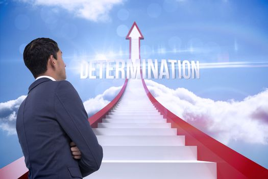 Determination against red steps arrow pointing up against sky