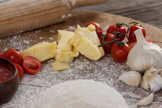 Pizza dough, flour, rolling pin, with ingredient