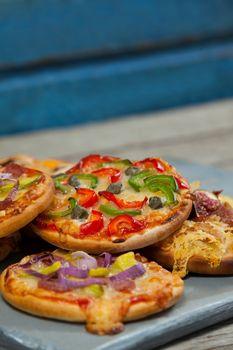 Various delicious italian pizza on pizza peel