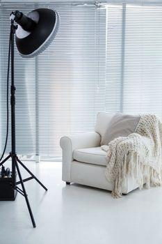 Armchair and spotlight in photostudio