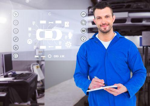 Portrait of a smiling automobile mechanic holding clipboard