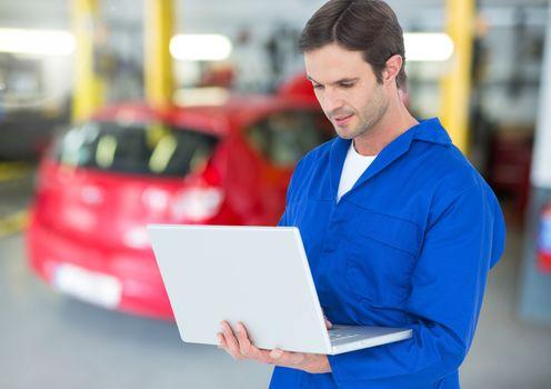 Automobile mechanic using laptop
