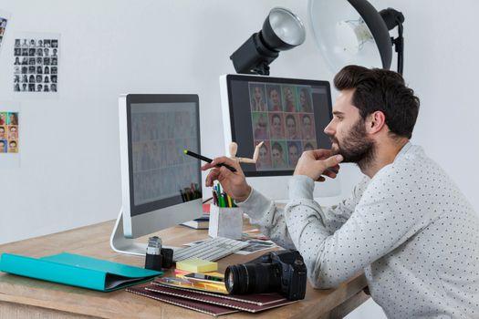 Photographer working on desktop pc