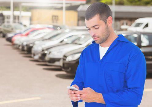Automobile mechanic using mobile phone