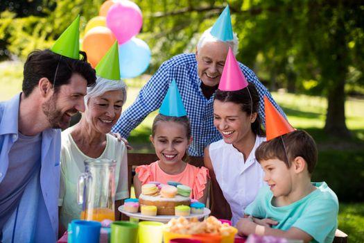 Happy multigeneration family celebrating birthday party in park