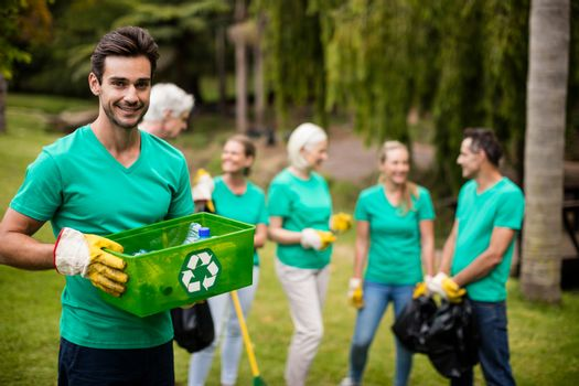 Recycling team member standing in park