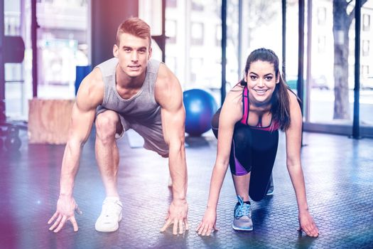 Athletic couple stretching