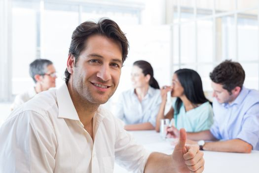 Attractive businessman smiling in the workplace