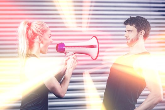 Trainer yelling through megaphone