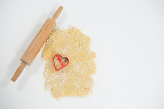Rolling pin and cookie cutter on dough