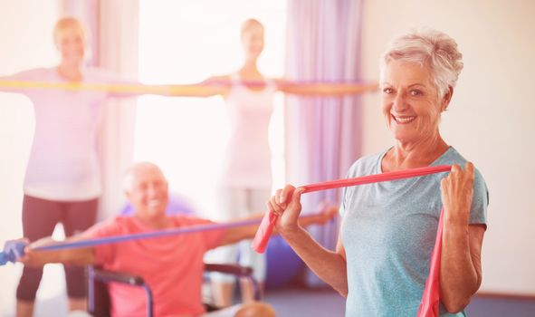 Portrait of seniors exercising with stretching bands