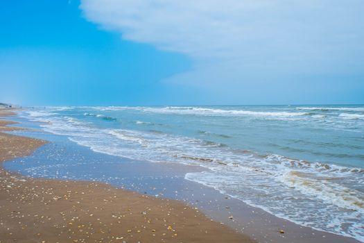 A beautiful soft and fine sandy beach along the gulf coast of South Padre Island, Texas