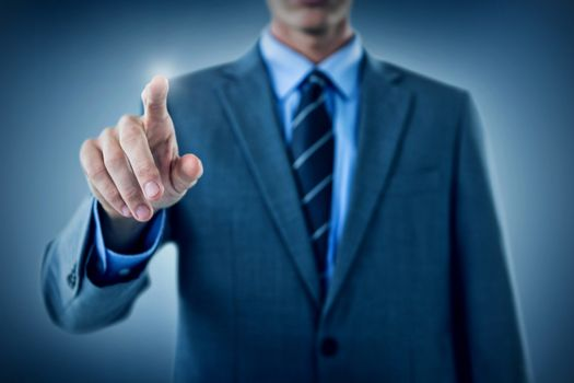 Composite image of well dressed businessman pointing