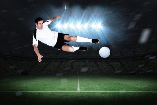 Football player in white kicking