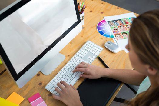 Woman working on desktop pc