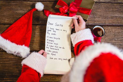 Santa Claus reading scroll