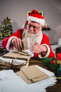 Santa Claus removing a letter