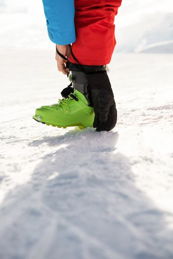 Skier tying his boot strap