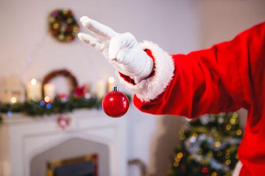 Santa claus holding a bauble