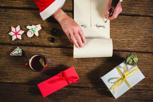 Santa Claus writing on scroll
