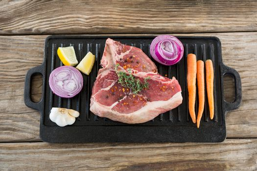 Sirloin chop and ingredients on grill tray