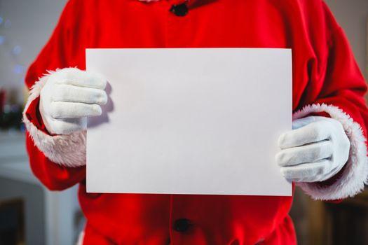 Santa claus holding a placard