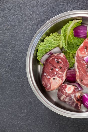 Sirloin chops and ingredients in frying pan