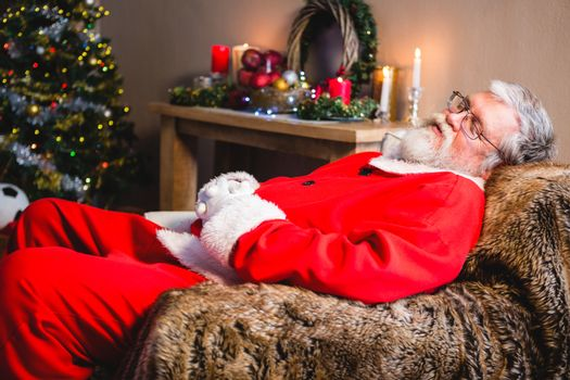 Santa claus taking a nap on sofa