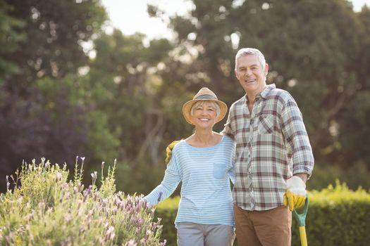 Senior couple standing in backyard