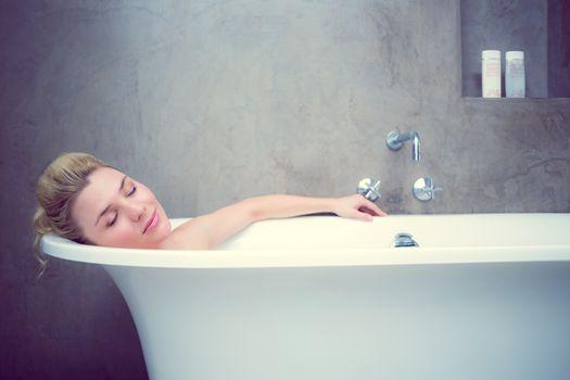 Serene blonde lying in the bath