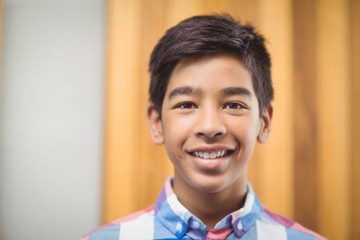 Portrait of smiling schoolboy in school
