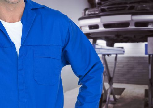 Mechanic standing at garage