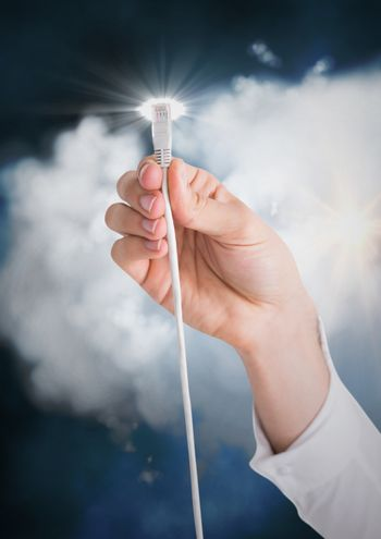 Human hand connecting cable to the cloud