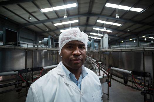 Factory engineer standing in bottle factory