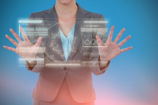 Composite image of businesswoman using digital screen