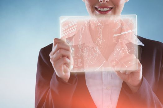 Composite image of businesswoman pretending to use digital tablet