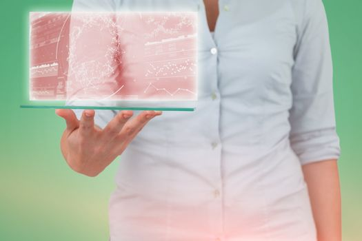 Composite image of midsection of businesswoman pretending to hold digital tablet