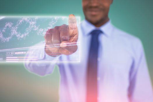Composite image of businessman using digital screen