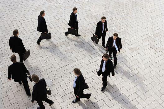 Businessman walking round in circles