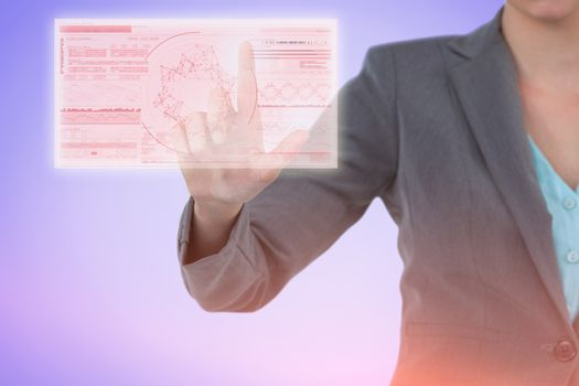 Composite image of businesswoman using invisible digital screen