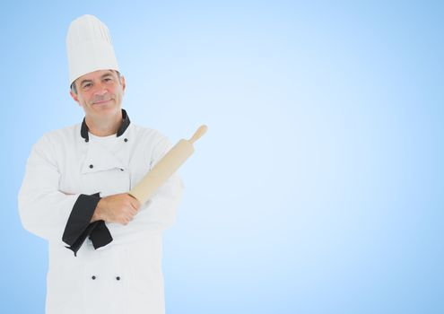 Chef with rolling pin against blue background