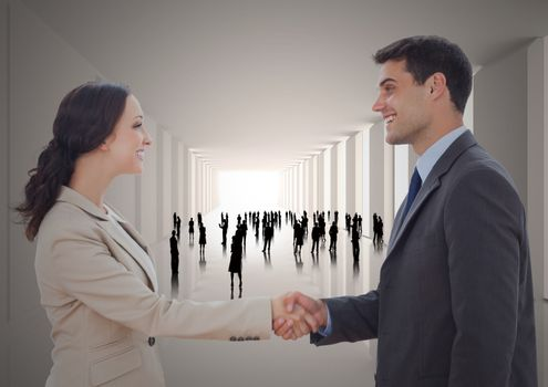 Handshake in corridor with silhouettes