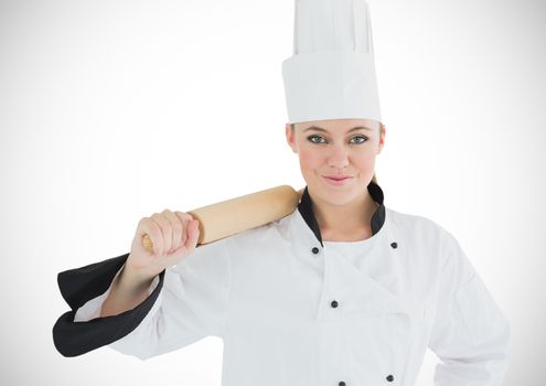 Chef with rolling pin against white background