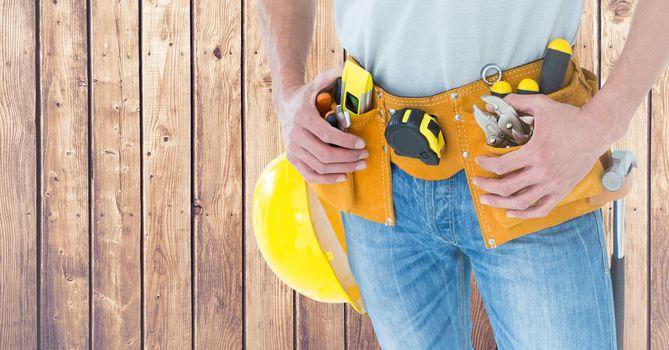 Carpenter against wood panel