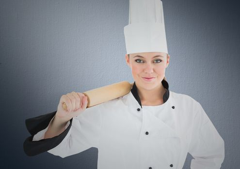 Chef with rolling pin against navy background