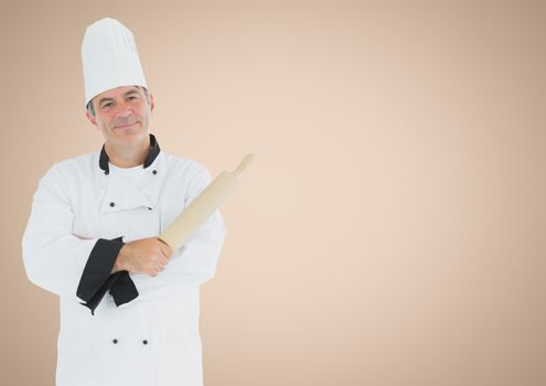 Chef with rolling pin against cream background