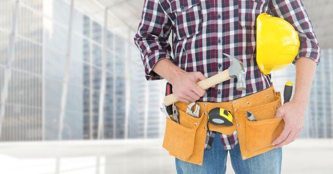 Carpenter with hammer against window