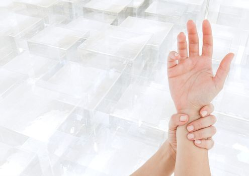 Composite image of hands restraining against overview of buildings